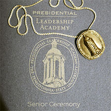 Program and medal from PLA Senior Ceremony