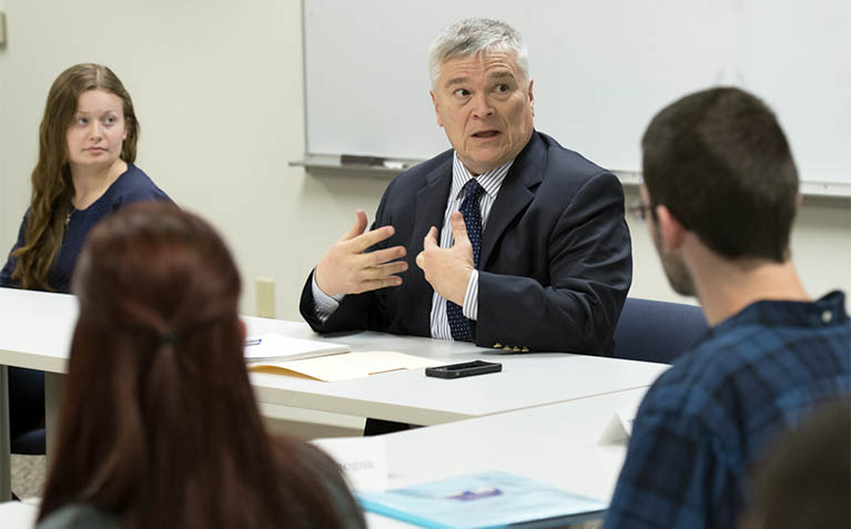 President Barron talking with students during PLA class